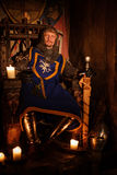 Medieval king on throne in ancient castle interior. Old medieval king on the throne in ancient castle interior royalty free stock photos