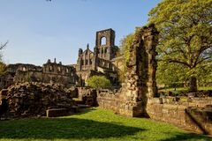Medieval Kirkstall Abbey near Leeds. Kirkstall Abbey is a ruined Cistercian monastery in Kirkstall, north-west of Leeds city centre in West Yorkshire, England Royalty Free Stock Photo