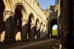 Medieval Kirkstall Abbey near Leeds. UK. Kirkstall Abbey is a ruined Cistercian monastery in Kirkstall, north-west of Leeds city centre in West Yorkshire Stock Images