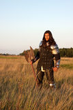 Medieval knight. In the field with an axe stock photo