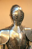 Medieval knight. Armor in front of a yellow wall Royalty Free Stock Image