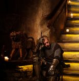 Medieval knight in ancient castle  interior. Royalty Free Stock Images