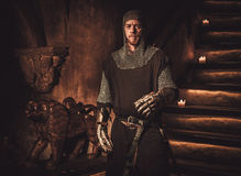 Medieval knight in ancient castle interior. Stock Photography
