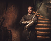 Medieval knight in ancient castle interior. Royalty Free Stock Photos