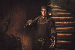 Medieval knight in ancient castle interior. Medieval knight in ancient castle interior Royalty Free Stock Images