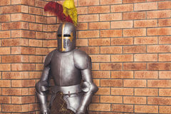 Medieval knight armor against the background of a brick wall.  Stock Photo