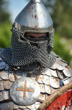 Medieval knight in armor and helmet Stock Images