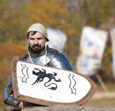 Medieval knight in armor without a helmet waiting for battle. Russia, Kamchatka - OCTOBER,  01, 2017: The first Kamchatka military historical festival in the Royalty Free Stock Image