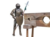 Knights armor with wooden pillory Stock Images
