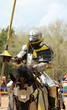 A Medieval Knight Receiving His Lance Before A Joust. A Medieval Knight in armor receiving his lance as he prepares to joust on his armored steed Stock Images