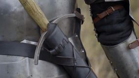 Medieval knight in armor and sword on the belt. Warrior in Renaissance armor stands in the field stock video