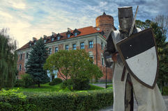Medieval knight. Armored knight with medieval castle in the background, Uniejow, Poland Royalty Free Stock Images