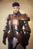 Medieval knight. In armour studio shot stock photography