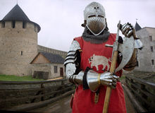 Medieval knight in the castle. In heavy armor Stock Images