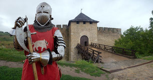 Medieval knight in the castle. In heavy armor Stock Photos
