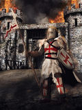 Medieval knight and castle. Medieval knight standing in front of a burning castle vector illustration