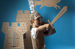 Medieval knight child. Photo of the boy in medieval knight costume made of cardboards Royalty Free Stock Photos