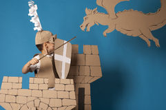Medieval knight child. Photo of the boy in medieval knight costume made of cardboards. this decorations are made specially for this photosession by me Stock Photography
