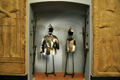 Medieval knight costume. Iron medieval knight costume and swords in a museum in Italy royalty free stock images