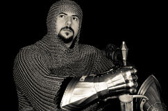 Medieval Knight. Medieval costume including chain mail, sword and gauntlets stock photography