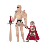 Medieval knight in decorated metal suit and armor bearer, squire Stock Photography