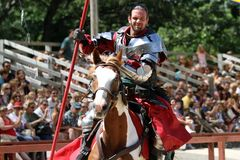 Medieval knight demonstrate skills on horseback stock images