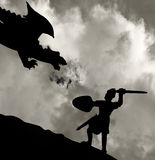 Medieval knight fighting the dragon. Silhouette of a medieval knight fighting the dragon Royalty Free Stock Images