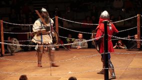 Medieval knight fighting, reconstruction of medieval battles. Full contact knight fighting. stock footage
