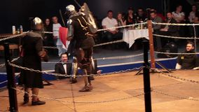 Medieval knight fighting, reconstruction of medieval battles. Full contact knight fighting. stock video footage