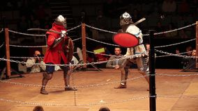 Medieval knight fighting, reconstruction of medieval battles. Full contact knight fighting. stock video