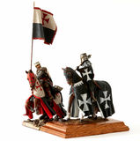 Medieval knight figurine. Medieval knight statuette isolated on white Royalty Free Stock Photo