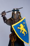 Medieval knight in full armor. Medieval knight isolated on grey background Royalty Free Stock Images