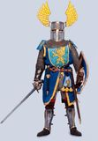 Medieval knight in full armor standing. Medieval knight isolated on grey background Royalty Free Stock Image