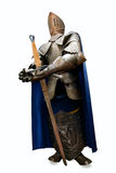 Medieval knight full armor with sword. Isolated on white Royalty Free Stock Photos