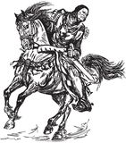 Medieval knight galloping his horse royalty free stock photography