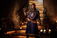 Medieval knight on guard in castle interior. Royalty Free Stock Images