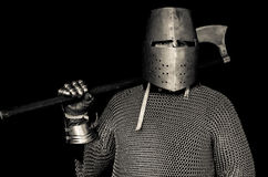 Medieval Knight with Helmet and Axe. Medieval costume including helmet, chain mail, axe and gauntlets stock photos
