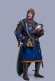 Medieval knight with helmet in his hand. Medieval knight on grey background Royalty Free Stock Photography