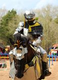 A Medieval Knight in armor on his stead. stock photo