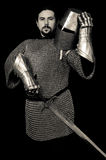 Medieval Knight holding Helmet and sword Royalty Free Stock Photos