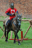 Medieval knight on a horse. A medieval knight mounting a horse Stock Images