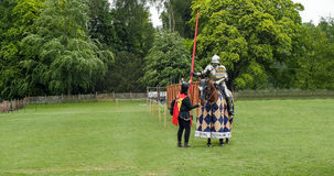A medieval knight and horse in armour and costume for a joust Royalty Free Stock Photos