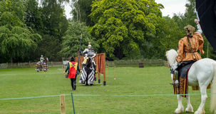 A medieval knight and horse in armour and costume ready for jousting Stock Photo