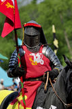 Medieval knight on horseback. In a tournament royalty free stock photos