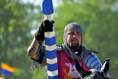 Medieval knight on horseback. In a tournament Royalty Free Stock Photography