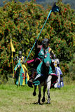 Medieval knight on horseback. In a tournamant Stock Images
