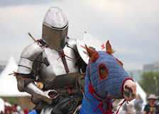 Medieval knight on horseback, side view Stock Photos