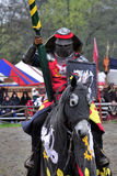 Medieval knight on horseback. In a tournament Royalty Free Stock Image