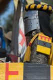 Medieval knight in iron helmet prepares to fight Royalty Free Stock Images