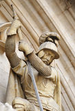 Medieval knight killing a dragon Stock Image